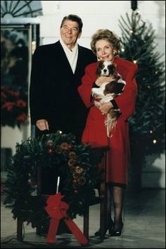 Ronald Regan posing with his dog Rex (King Charles Cavalier Spaniel).