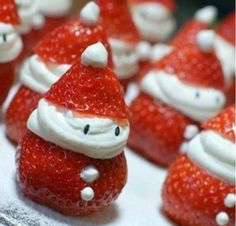 Snowman Treat -   1 lb large strawberries  1 (8 ounce) package cream cheese, softened  3-4 Tablespoons powdered sugar   1 teaspoon vanilla extract