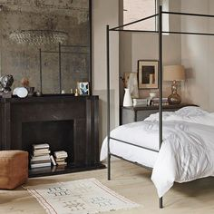 Chic master bedroom, love the black fireplace surround & the Eclectic mix of styles & textures
