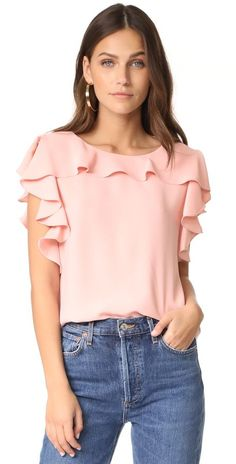 colette top by Amanda Uprichard. Cascading ruffles bring playful style to this loose Amanda Uprichard top. Buttoned keyhole in back. Teen Fashion, Fashion Outfits, Indian Bridal Outfits, Amanda Uprichard, Womens Sleeveless Tops, Corsage, Blouse Styles, Casual Tops, Dress Patterns