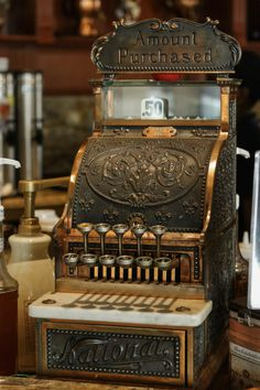 Antique cash register at Cafe Demetrio in Coral Gables, FL. ~ Timeless Elegance by Desiree photography