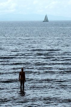 ANOTHER PLACE by ANTONY GORMLEY, CROSBY, ENGLAND, 2005. cast-iron statues on the beach