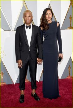 Oscars 2016: Pharell Williams with his wife Helen Lasichanh attend the ceremony, posing on the red carpet.