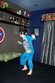 Super Superhero Room love the valance and the shelves