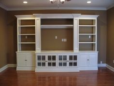 Built in entertainment center using IKEA Hemne pieces (2 bookcases, 2 glass door cabinets, and a TV unit) - Great inspiration! Description from pinterest.com. I searched for this on bing.com/images
