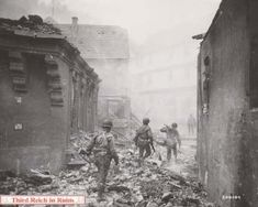 As GIs of the 62nd Armored Infantry, 14th Armored Division, make their way through the ruins of Gemünden