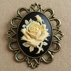 Check out this item in my Etsy shop https://www.etsy.com/listing/209909844/large-cameo-rose-brooch-in-brass-setting