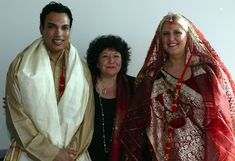 I've officiated Hindu-Jewish, Hindu-Catholic, Hindu-Muslim and Hindu-Buddhist weddings, to name a few, as well as a Hindu-Christian African American wedding where the couple walked around the sacred fire and jumped the broom. One or both partners may choose to wear traditional Indian garments, or they may opt for a tux and white dress.