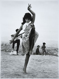 The 13-year-old Gypsy dancer Antoñita La Singla, barefoot on the dusty bluffs above Barcelona, wearing a wrinkled dress, with a white handkerchief tied at her neck, 1962- Photograph by Xavier Miserachs