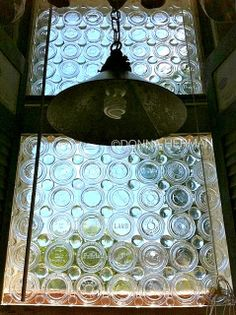 Crazy ridiculously amazing steampunk styled glass canning jar lid privacy window - by Donna Herman featured on http://www.ilovethatjunk.com