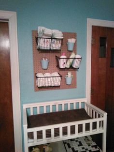 Our version of diaper changing peg station with peg board. Ideally i think id like to paint the peg board (white or gray) and the black baskets to better match our decor but its too cold out for that right now and new baby is coming this week so painting will wait till spring is in full bloom!