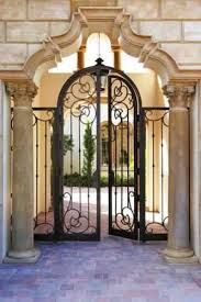 Double wrought iron courtyard gates