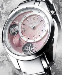Fossil Women's watch--Twist Pink MOP partially exposed mechanics let you see the inner-workings of the watch.  Stainless steel case and bracelet Three hands quartz movement.