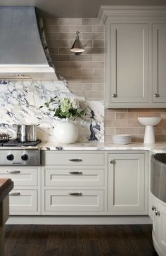so cool how the cut the granite to mimic the lines of the hood  grey kitchen