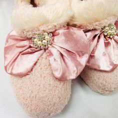 Mischia is a new full slipper – slightly bootie style with a soft and luxurious fabric. The top is accented with a large satin fabric bow with a big jeweled ...