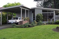 Mid-century modern with vintage Ford Falcon in carport...