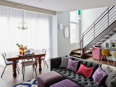 Accents in colors like yellow, fuchsia, and purple create focal points in a shared living and dining space.