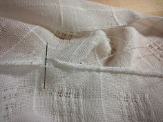 Hand-stitched rolled hem on handwoven Swedish lace cloth.