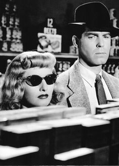 Double Indemnity (1944) I love this picture. The clandestine meeting at the grocery store incognito. They both look extremely suspicious to me.