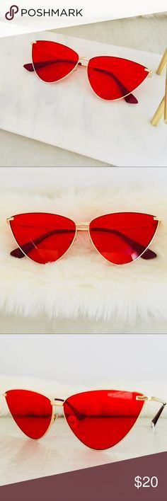 Gold & Red Sunglasses Very chic red triangular lenses on a sturdy classic gold frame. I'm loving these, red is HOT this season.  I also have these in black on black. LYB Accessories Sunglasses