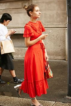Taking serious inspiration from this beautifully bright street style in Milan. A vibrant orange tie round maxi dress with block heeled sandals and hair up for a relaxed look.