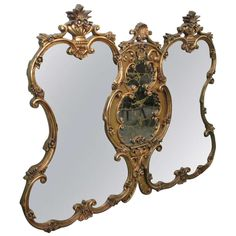 Large Italian Rococo Renaissance Triple Mirror With Eglomise Center | From a unique collection of antique and modern wall mirrors at http://www.1stdibs.com/furniture/mirrors/wall-mirrors/