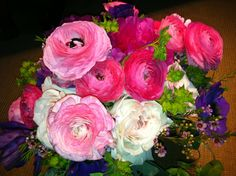 A bright & lush bridal bouquet of loose [and perfectly bloomed!] Ranunculas, garden roses, anemones, peonies and buplerum. www.fioreofpensacola.com