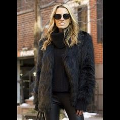 Faux Fur Black Jacket Beautiful on trend fur jacket!  Image of model is for styling only - not the actual jacket!  Fully lined.  Recently dry cleaned - in beautiful condition!  Comes from a non smoking home. Jones New York Jackets & Coats