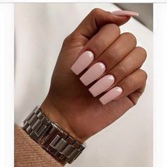 [NAILS: Soft pink nail color on brown skin.]