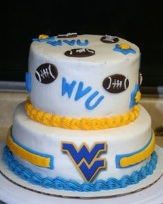 This is my WVU cake.  It is all buttercream icing with fondant accents.