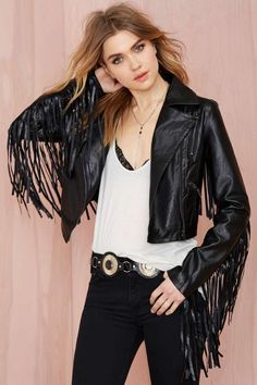Raise some hell in this rad black vegan leather jacket featuring zip pockets and fringe detailing at sleeves and back.