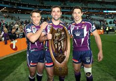 Cooper Cronk, Cam Smith and Billy Slater doing their lap of honour with the NRL Premiership trophy!