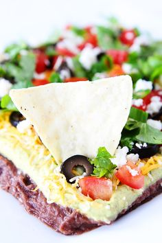 Mexican Layer Dip Recipe on twopeasandtheirpod.com This easy dip is great for game day, parties, or every day snacking!