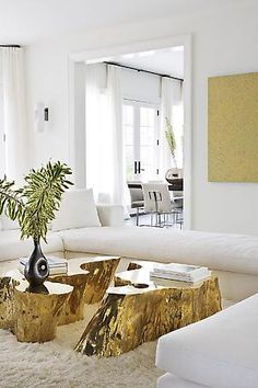 gold colored tree trunk pieces = coffee table