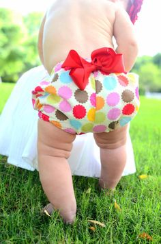 These adorable diaper covers are made with 100% cotton fabric and embellished with a red grossgrain removable bow. They are size 6-12 months and have an elastic waistband. MEMBER - B. Belle Couture