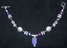 Bracelet with Wire-wrapped Blue Glass Bead, Silver-tone Discs, Blue Glass Beads, Crackle Beads, Clear Rondelles, Toggle Clasp