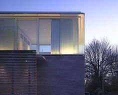 Burren House by Níall McLaughlin Architects. #Stone base with #Glass upper story.  #Residential
