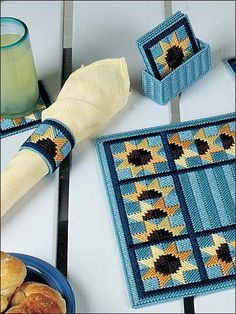 Bring some sunflowers into your home with this 4 piece set that includes napkin holder, napkin ring, coaster and place mat. All are stitched on 7-count plastic canvas with worsted weight yarn. Skill Level: Easy Plastic Canvas Coasters, Plastic Canvas Crafts, Plastic Canvas Patterns, Mug Rugs, Tissue Box Covers, Tissue Boxes, Needlepoint Stitches, Embroidery Stitches, Canvas Art