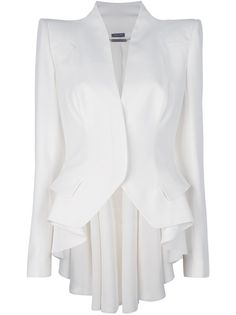 Boutique Bernard, London, United Kingdom DESCRIPTION Ivory crepe coat from Alexander McQueen featuring padded shoulders, v-neck, full length sleeves with button fastened cuffs, two flap pockets to the sides and a pleated dipped back hem. The coat has concealed buttons down the front for closure and is fully lined.