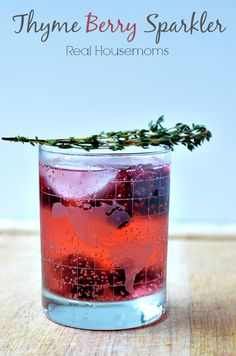Thyme Berry Sparkler | Real Housemoms | I love the flavor of the thyme with the berries and look how pretty!