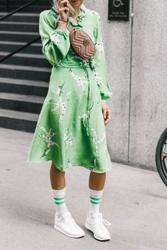 Loving this floral bright green dress with white tennis shoes. Super chic!