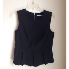 Kimchi blue peplum top Black peplum top with back zip closure. Can dress it up or down. Size L but fits like a M. In great condition! Urban Outfitters Tops