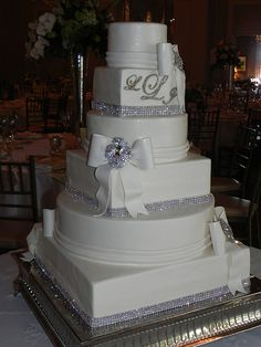 Rhinestones and brooches wedding cake with bows and monogram