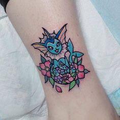 Kawaii style vaporeon tattoo on the leg. Tattoo artist: Carla Evelyn