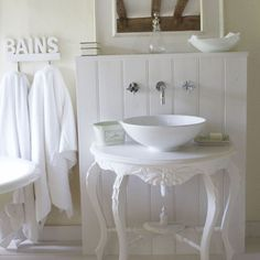 Lovely bathroom sink.  Paint an old side table white, purchase or repurpose a bowl sink, add fixtures, and wha-la!  There you have it. Hugs, Linda :)