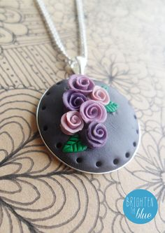 A lovely purple rose necklace available on Etsy https://www.etsy.com/uk/listing/163001263/purple-rose-floral-polymer-clay-pendant #necklace