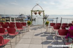 A handmade arch to complement the Lake Champlain backdrop for a sunny, summer ceremony on the upper deck | The Portrait Gallery