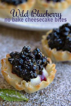 Wild Blueberry No Bake Cheesecake Bites, cheesecake filling piped in mini phyllo cups and topped with wild blueberry sauce. - ThisSillyGirlsLife.com