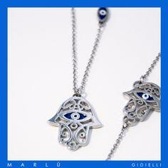 Collana in acciaio con Mano di Fatima in acciaio e smalto blu della collezione #Segni.  Steel Necklace with Fatima's Hand and blue enamel. #ManoDiFatima Collection