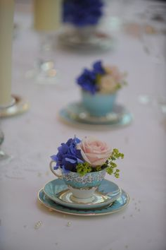 Vintage tea cups and fresh flowers. I can put fresh cut roses from my rose tree in each cup and they get to keep it when they pick their cup.